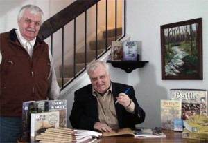 Bob Coggins (seated) with S. Craig Taylor (left) at the re-release of Napoleon's Battles.